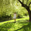 Young bride stood under the greenwood tree — Stock Photo #5998984