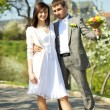 Just married in a flowering garden — Stock Photo #5999217