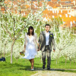 Stock Photo: Just married in a flowering garden
