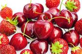Pozadí třešní a jahod — Stock fotografie