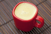 Cup of cappuccino on a bamboo mat — Stock Photo