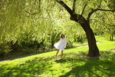 Young bride stood under the greenwood tree — Stock Photo
