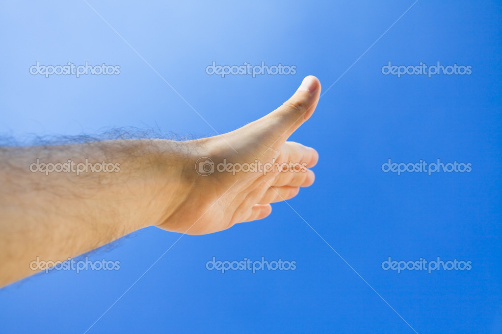 Hand against the blue sky — Stock Photo #5995285