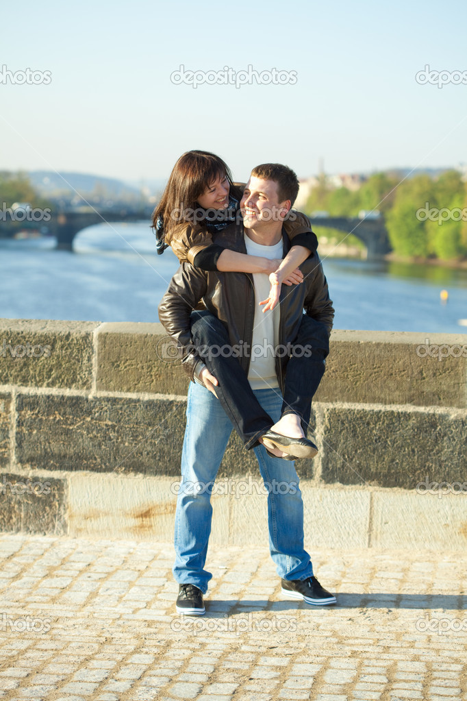 Young couple on the Charles Bridge  Stock Photo #5996303