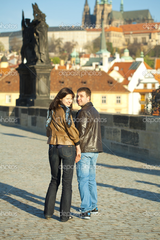 Young couple on the Charles Bridge  Stock Photo #5996309