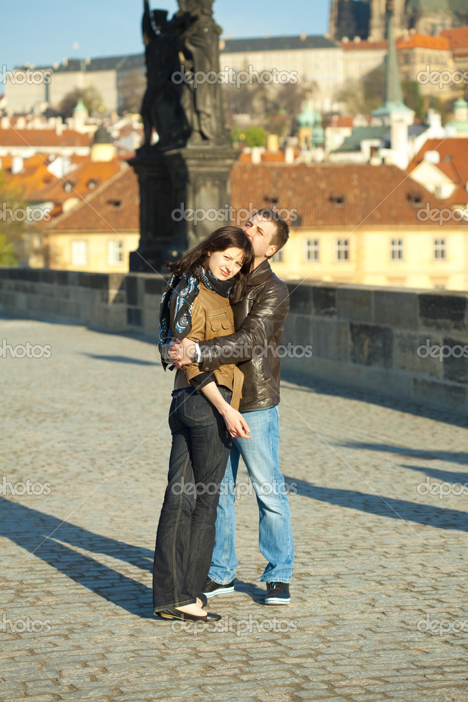 Young couple on the Charles Bridge — Stock Photo #5996316