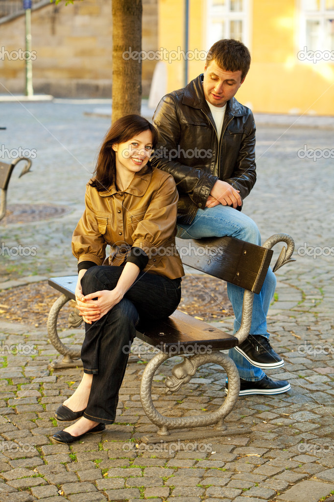 Love couple sitting on a bench — Stock Photo #5996554