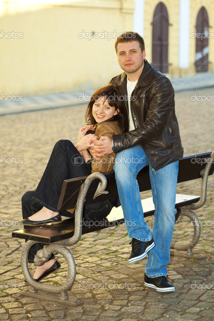 Love couple sitting on a bench — Stock Photo #5996566