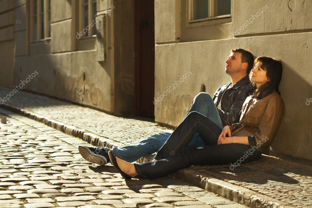 Love couple sitting on the pavement  Stock Photo #5996579