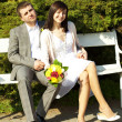 Just married sitting on the bench — Stock Photo