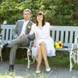 Stock Photo: Just married sitting on the bench