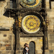 Stock Photo: Young couple in love at Prague's astronomical clock
