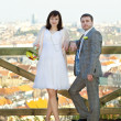 Just married against the background of Prague — Stock Photo