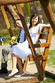 Just married at swing — Stock Photo