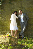 Just married standing by the stone — Stock Photo