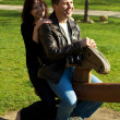 Young couple in a baby swing — Stock Photo