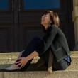 Young woman sitting on the steps — Stock Photo
