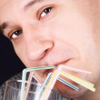 Portrait of a man drinking a cocktail — Stock Photo