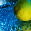 Stock Photo: Lemon and water drops