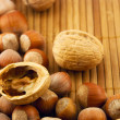 Stock Photo: Nuts on a bamboo mat