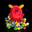 Toys and sweets on a black background — Stock Photo