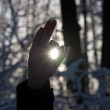 Stock Photo: Man holding a sun in his hands against the sky