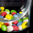 Multi-colored candies in a glass jar — Stock Photo #6015364