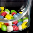 Multi-colored candies in a glass jar — Stock Photo