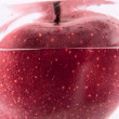 Red apple in the water — Stock Photo #6015544