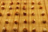 Hazelnuts on a bamboo mat — Stock Photo