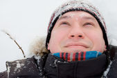 Portrait of a man in a winter forest — Stock Photo