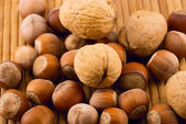 Nuts on a bamboo mat — Stock Photo