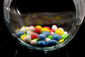 Sweets in glass jar — Stock Photo