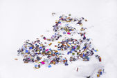 Heart of confetti isolated on white — Stock Photo