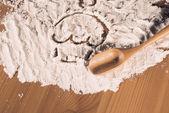 Cake painted on flour — Stock Photo