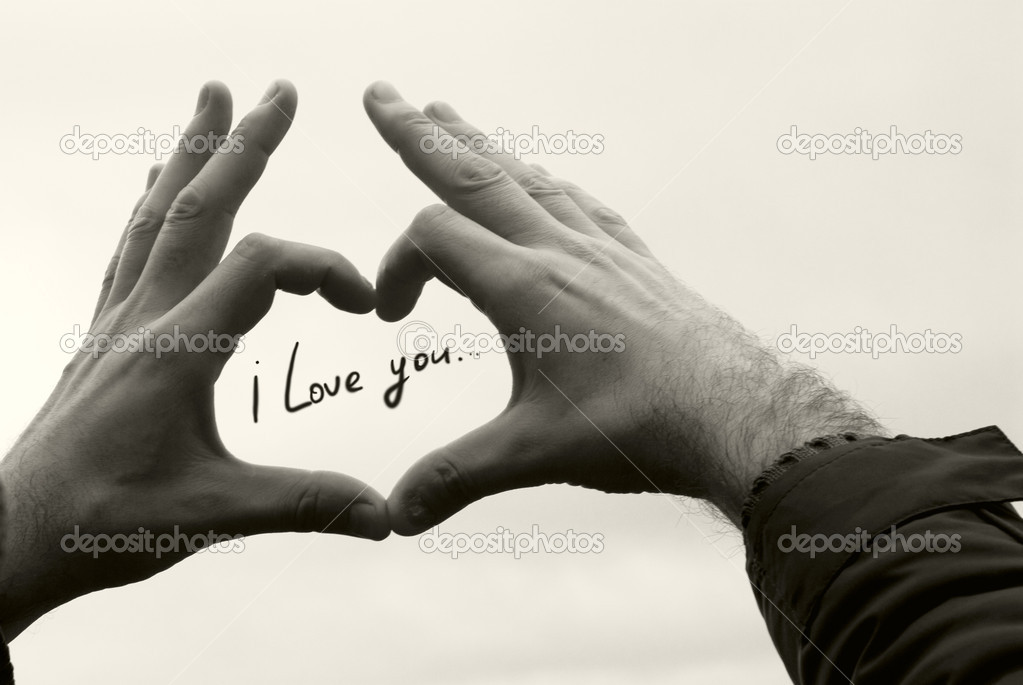 I love you in the hands of men against the sky — Stock Photo #6012098