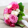 Bridal bouquet lying on the stone parapet — Stock Photo