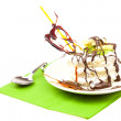 Cake with whipped cream and caramel heart lying on a green cloth — Stock Photo