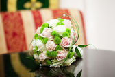 Beautiful bridal bouquet lying on the table — Stock Photo
