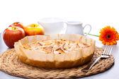 Still life of apple pie, apple Gerbera milk jug and a cup — Stock Photo