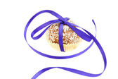 Cake with coconut tied with ribbon isolated on white — Stock Photo