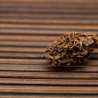 Dried walnut on a bamboo mat — Stock Photo