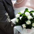 The bride and groom with a bouquet of flowers - Stockfoto