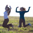 Beautiful teenager  woman jumping outdoors - Foto Stock