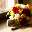 Bridal bouquet and a ring lying on the windowsill — Stock Photo