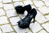 Shoes standing on the pavement — Stock Photo