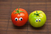 Tomato with eyes on a bamboo mat — Stock Photo