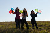 Beautiful teenager woman with a balloons outdoors — Stock Photo