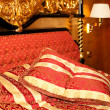 Bed in the gold room of the hotel — Stock Photo