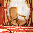 Bed and chair in the gold room of the hotel — Stock Photo #6070961